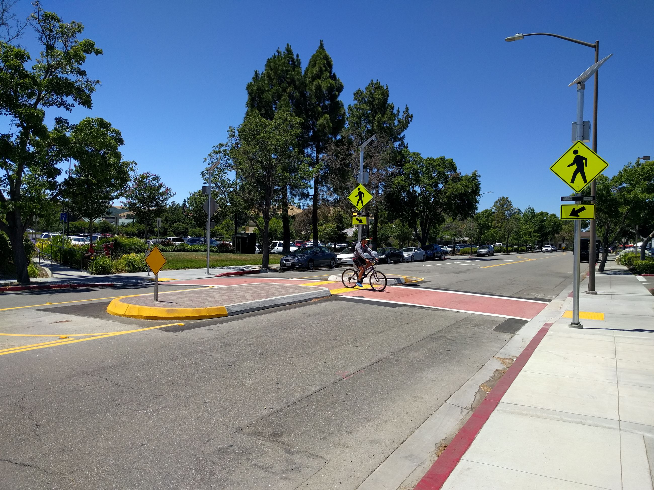 Mid-block crosswalk with cyclist on Amador Plaza Road