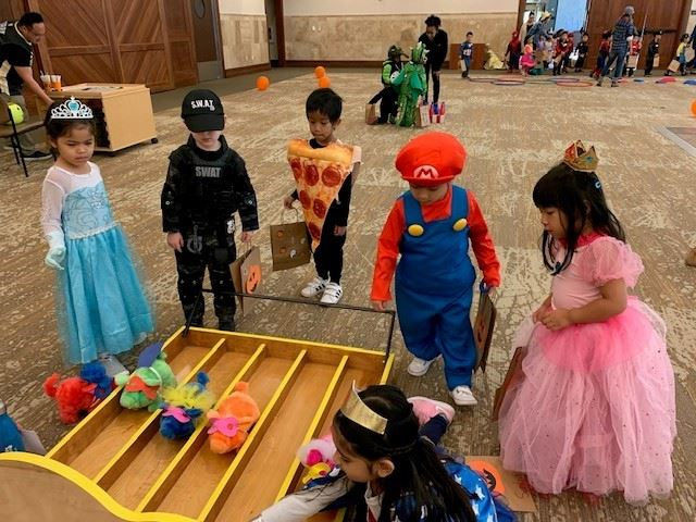 Preschoolers at Halloween Festival playing games