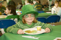 girl eating green pancakes